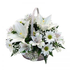 Flower arrangement in basket in white colors for funeral