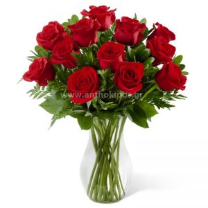 Bouquet with red roses in glass vase