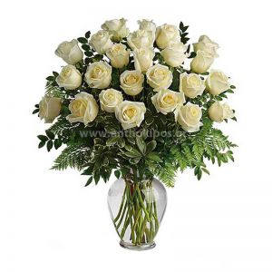 Bouquet with white roses in glass vase