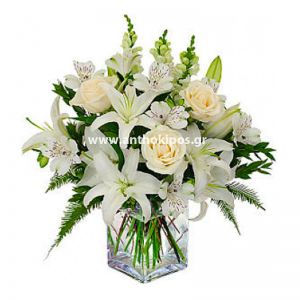 All white bouquet in glass vase