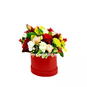 Colorful flower arrangement in red round box