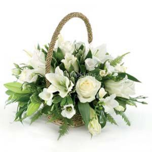 Flowers in a basket in white shade for funeral