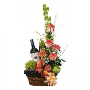 Flower arrangement with drink and fruits