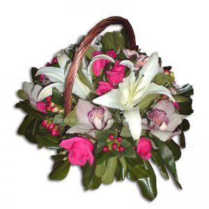 Flower arrangement in white-fuchsia shade in basket with handle