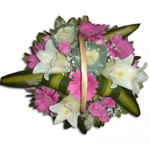 Flower arrangement in basket with handle in white-pink color