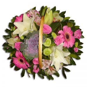 Flower arrangement in fuchsia-white shade in basket with handle