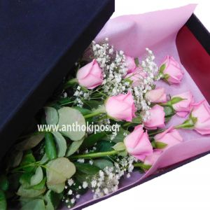 Pink roses in black velvet box