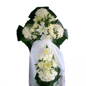Funeral flowers cross