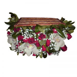 Flower Arrangements in trunk with red roses and white orchids(cymbidium) and gypsophila