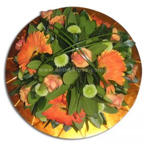 Flower arrangement in platter for table
