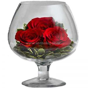 Roses with import folliages in a glass of cognac