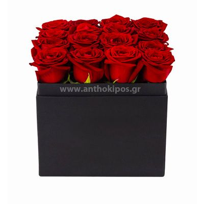Red roses in black square box in row