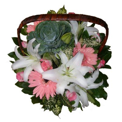 Flower arrangement in white-pink color in basket with handle