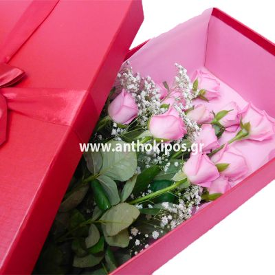 Pink roses in red box