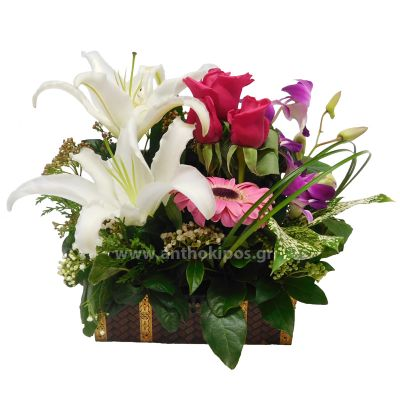 Flower Arrangement in trunk with pink flowers